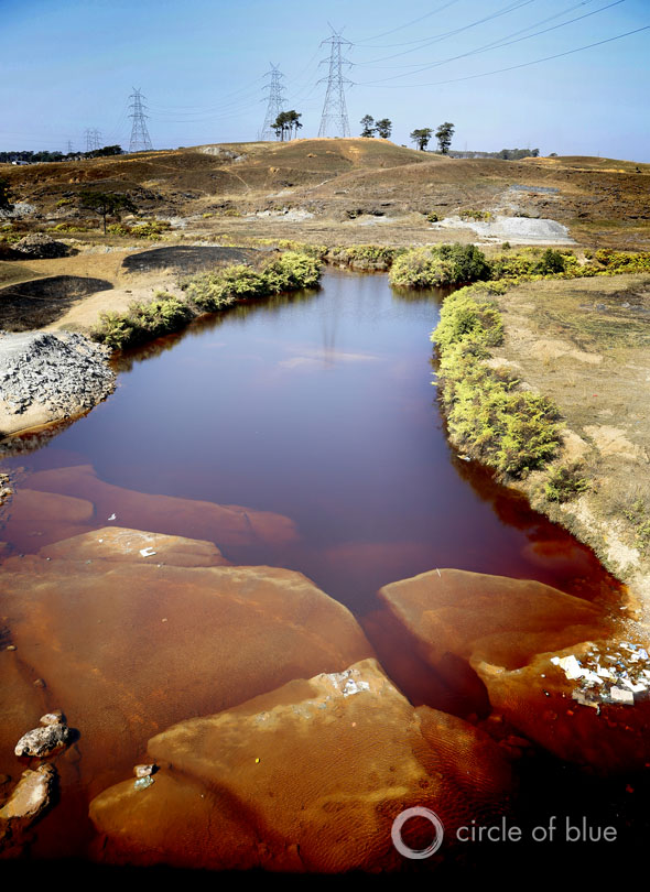 The high-sulfur coal from Meghalaya's mines mixes with water to form an acidic solution that turns streams the color of dried blood.