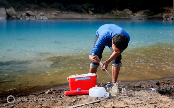 On the banks of the other wordly-blue Lukha River, Arshister Lyngdoh, a zoologist with the Meghalaya Pollution Control Board, tests the acidity of the water. It measured a pH of 4.5, sufficiently acidic to kill fish.