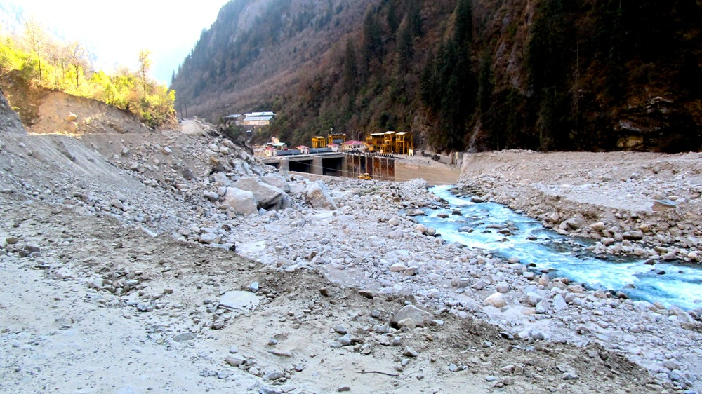 India Uttarakhand flood hydropower dams Himalaya climate change