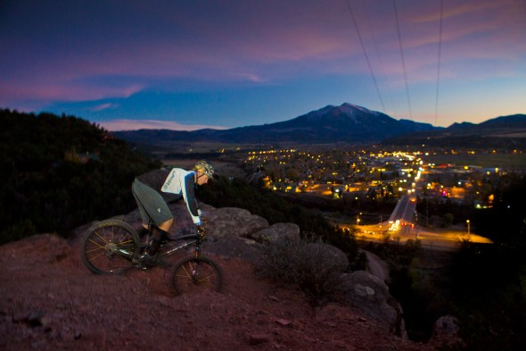 "Shawn Taylor of Snowmass Village rides his bike on Red Hill, overlooking the town of Carbondale. Mount Sopris, off in the distance, and the surrounding landscape are also a playground for the outdoors-minded residents. Carbondale veils the Thompson Divide, where local ranchers are offering to buy oil and gas leases to prevent drilling on public land. In addition, the Hidden Gems Campaign has proposed ""wilderness area"" on potential drilling sites. This has upset some bikers and climbers because pieces of their playground would no longer be available to them. Wilderness areas are foot traffic only."