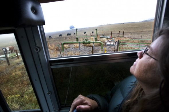 Lorie Syme (60) of Montrose — a small city with just over 40,000 people — looks out at a gas pipeline valve in Battlement Mesa during a tour of drilling sites led by Western Colorado Congress. Syme went on the tour because she wanted to learn more about the natural gas boom that has taken place in Colorado and across the country in recent years.