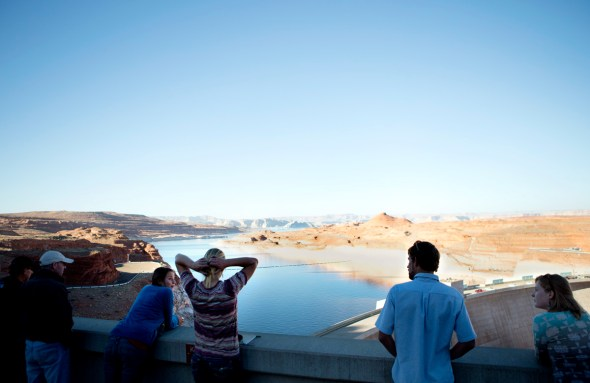 Students look over Lake Powell from the Glen Canyon Dam during an educational trip about water and energy on the Upper Colorado River with Eco-Flight.
