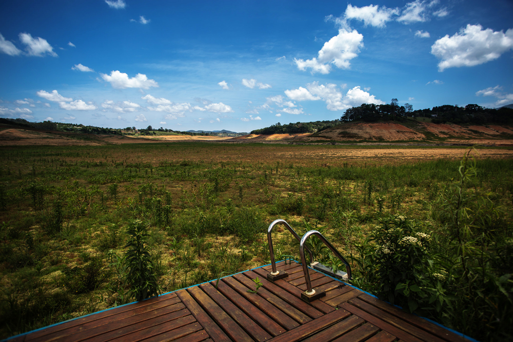 Water levels in Sao Paulo's Cantareira Reservoir system, shown here in November 2014, sank dangerously low during a two-year drought. Pollution in the city's other reservoirs compounded the problem. Photo courtesy Ninja Midia via Flickr Creative Commons