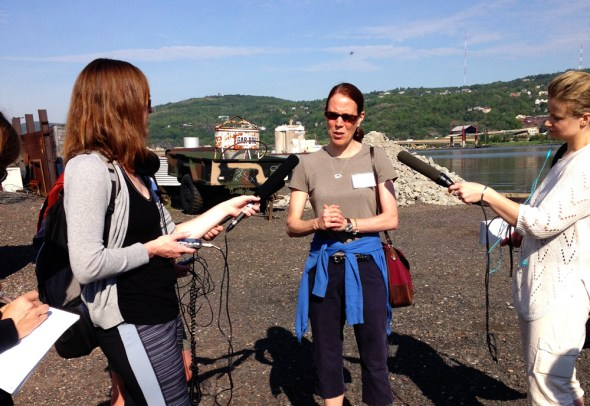 Lake Superior Institute for Journalism and Natural Resources IJNR Great Lakes journalists interview radio reporter microphone Kaye LaFond Circle of Blue