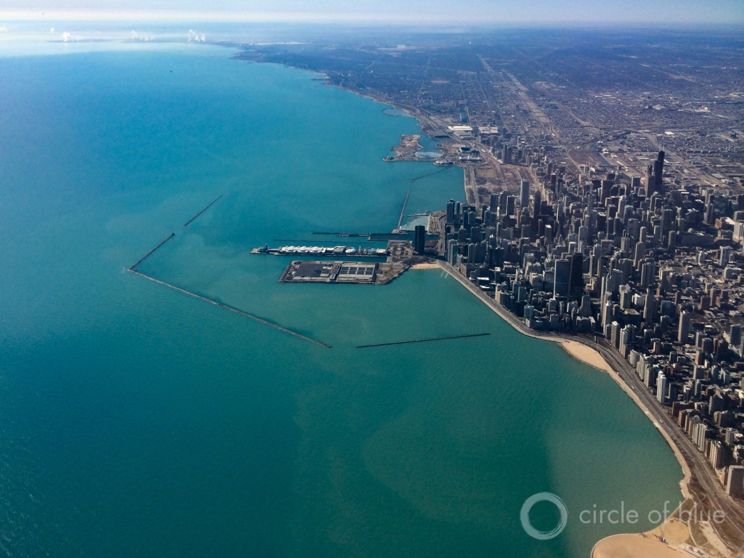 In a unanimous vote Tuesday in Chicago, the Great Lakes Compact Council approved the first out-of-basin diversion of Great Lakes water under the binational Great Lakes Compact. The decision grants Waukesha, Wisconsin access to Lake Michigan water for its municipal supplies. Photo © J. Carl Ganter / Circle of Blue
