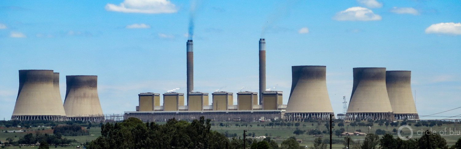 The 4,116-megawatt Kendal coal-fired generating station in Mpumalanga province, South Africa's central coal mining and coal-generating region, went into full commercial operation in 1988 and is visible from the site of the Kusile plant. Photo © Keith Schneider / Circle of Blue.