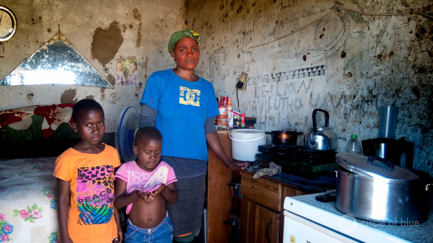 A laid off sugar cane farmworker and her children in Pongola.