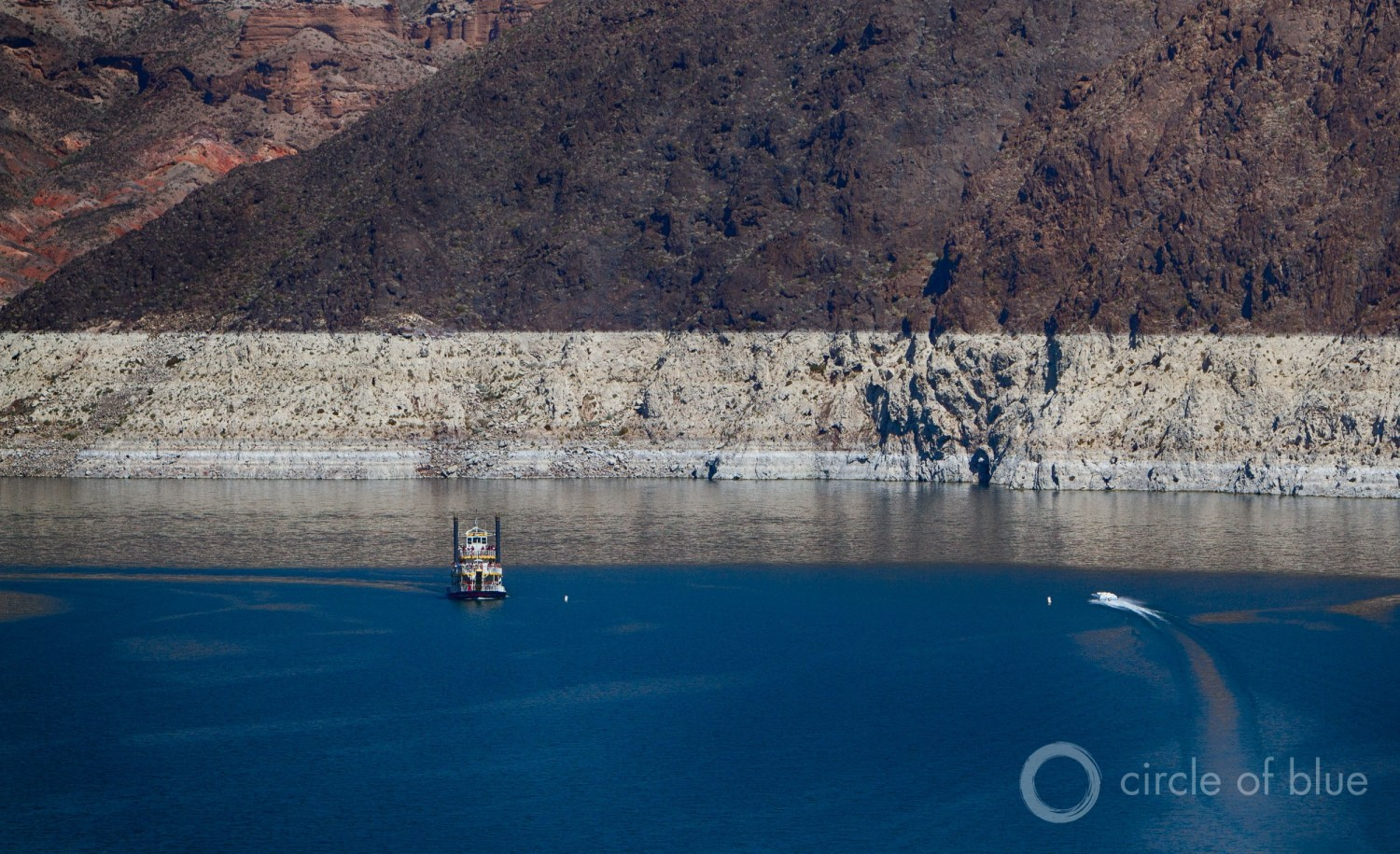 Lake Mead set a new record low on May 18, but the states that draw water from the big reservoir will not face mandatory restrictions in 2017. Water levels are not projected to drop low enough to trigger a first-ever shortage. Photo © J. Carl Ganter / Circle of Blue