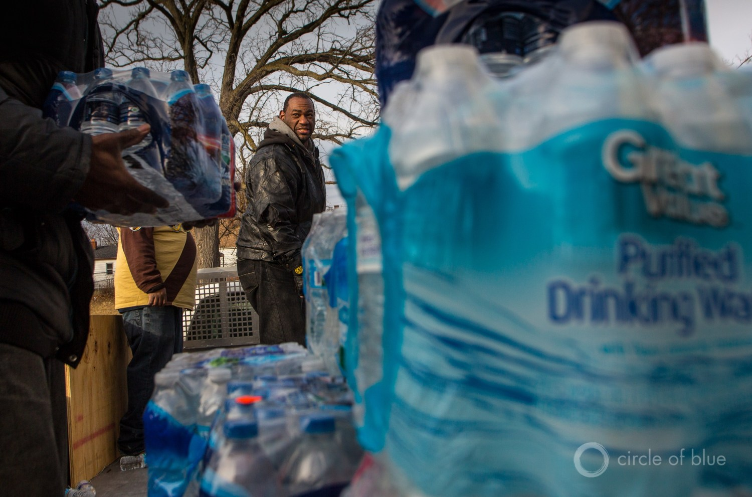 Residents unload bottled water at a distribution center in Flint, Michigan, on February 6, 2016.