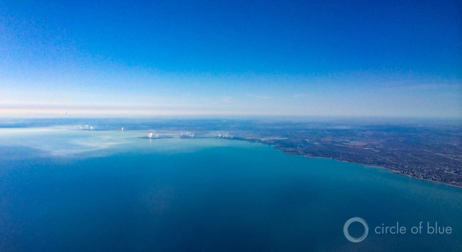 The city of Waukesha, Wisconsin, located just outside of the Great Lakes Basin, is asking to divert Lake Michigan water for its municipal supplies. The governors of eight Great Lakes states will vote on the proposal Tuesday in Chicago, shown here. Photo © J. Carl Ganter / Circle of Blue