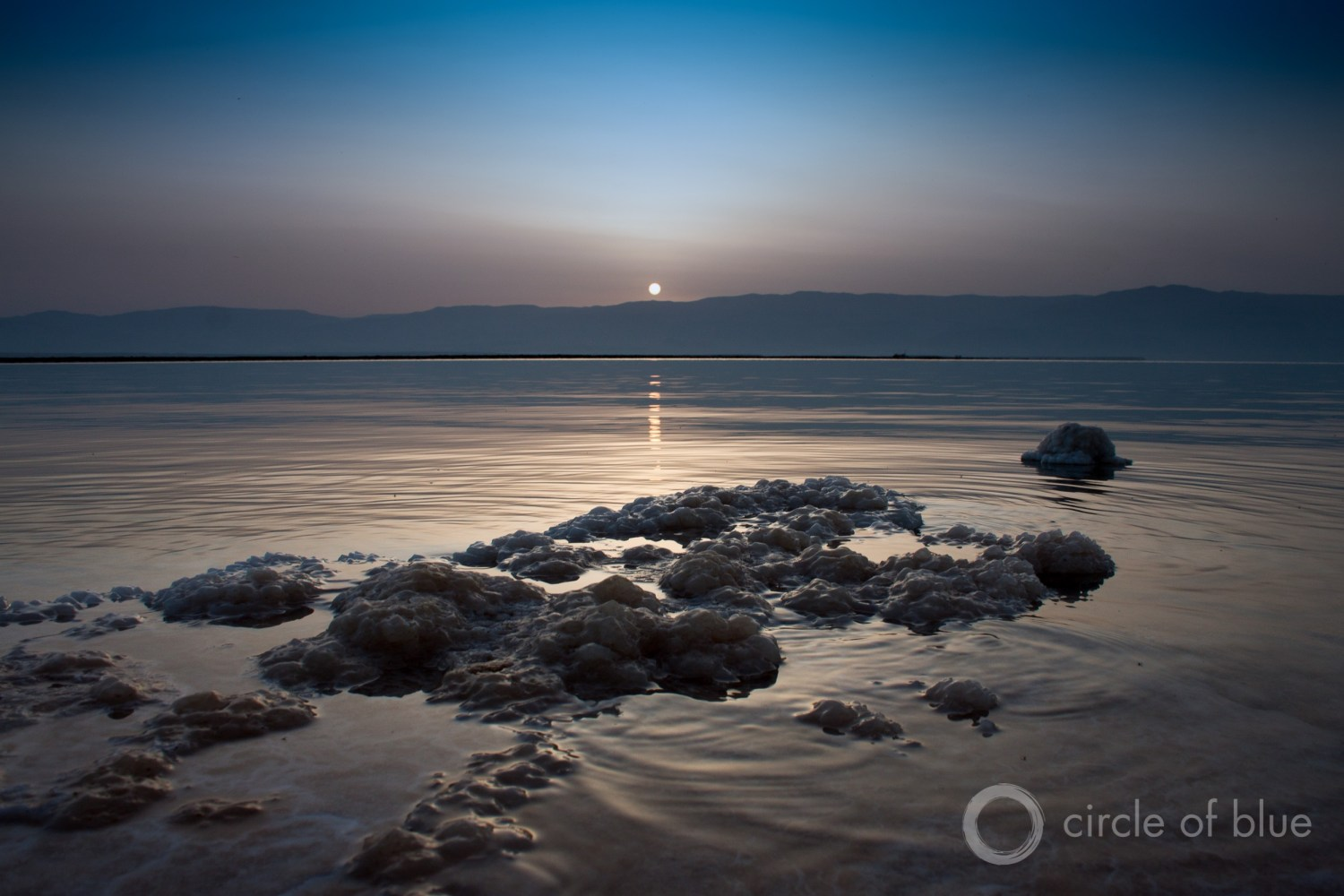Sunrise over the Dead Sea is veiled by haze. Halting the decline of the shrinking sea is a top water policy question in the Jordan River Basin. Photo © Brett Walton / Circle of Blue