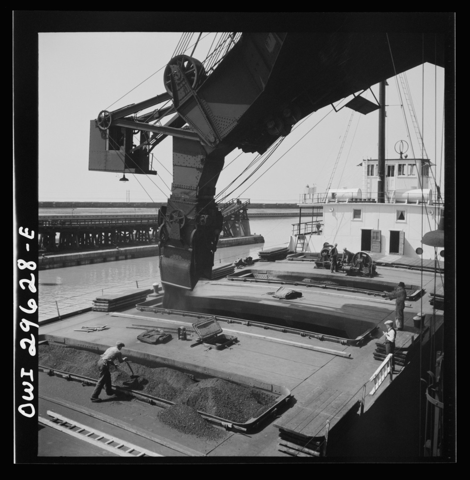 Coal is loaded onto a lake freighter at the Pennsylvania Railroad docks in Sandusky, Ohio in May, 1943. Photo Credit: Jack Delano / Library of Congress, Prints & Photographs Division, FSA/OWI Collection [LC-DIG-fsa-8d29908]