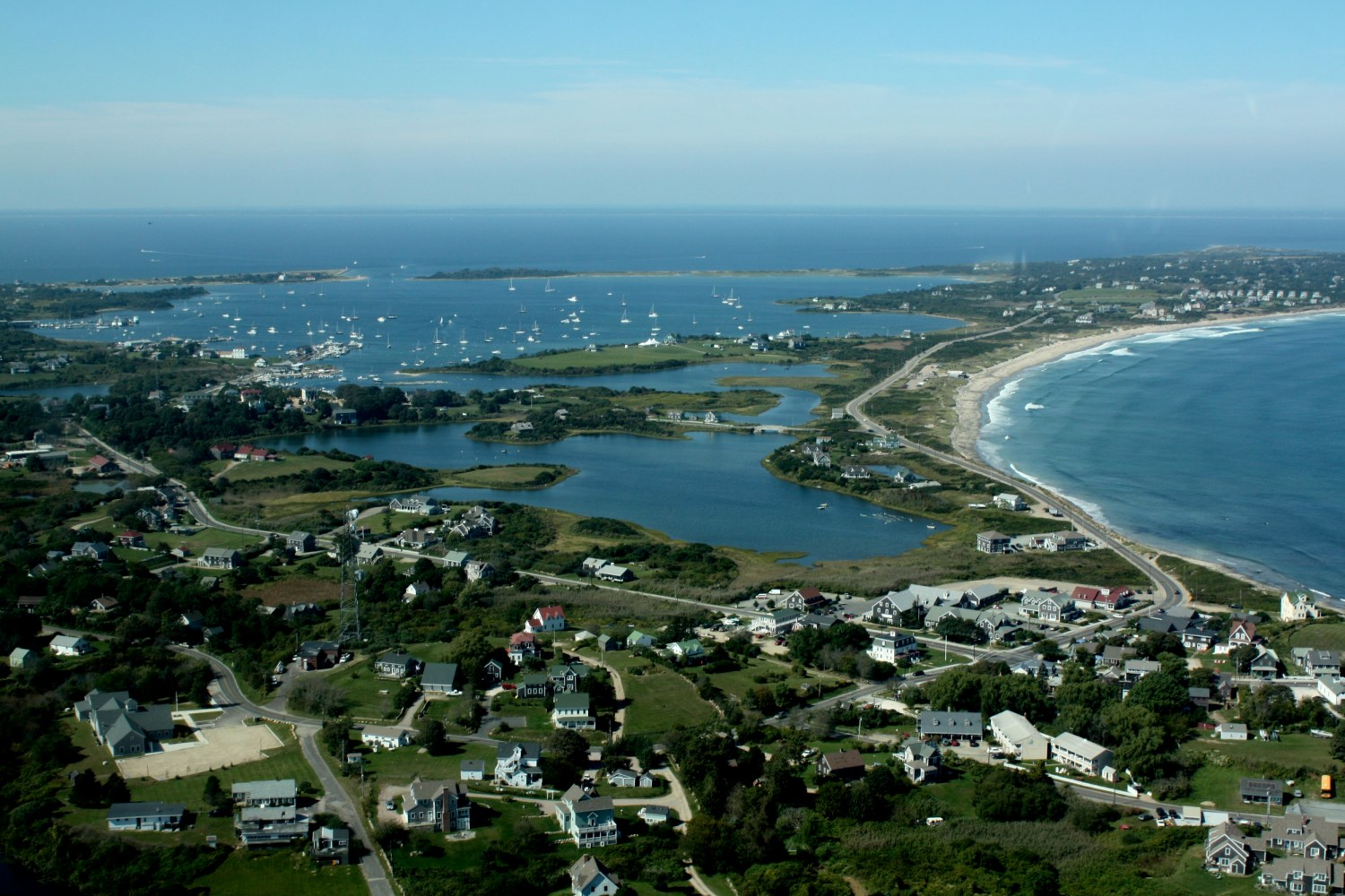 Block Island and the Rhode Island coast are dotted with homes, many of which use septic systems to dispose of toilet waste. Rising sea levels will render these systems less effective at removing bacteria and nutrients. Photo courtesy of Flickr/Creative Commons user eatswords