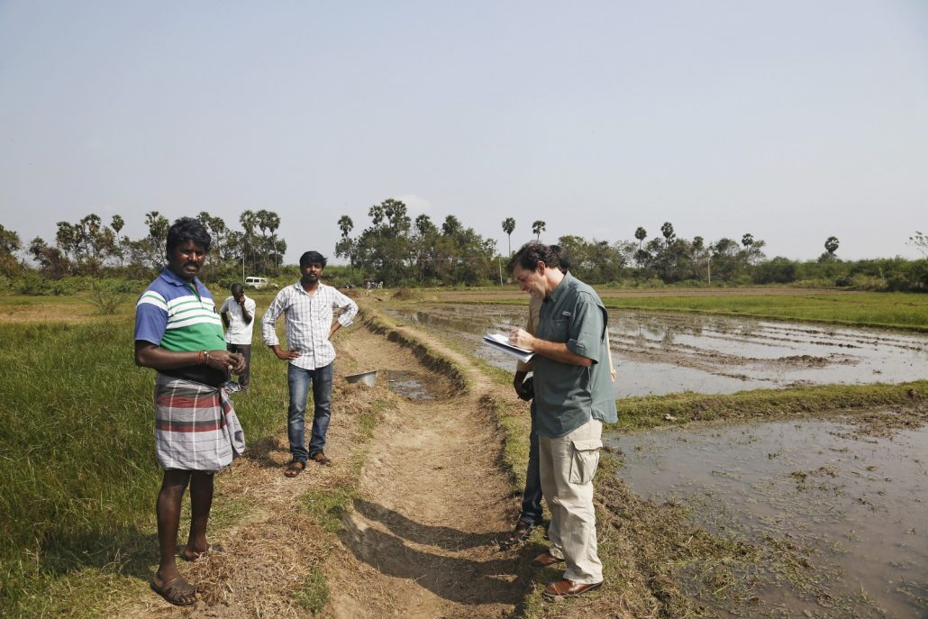 Keith Schneider interviews a local farmer (Keith has the farmers name written down) about the drought and using borewell groundwater for irrigation, in Chengalpet, Tamil Nadu.