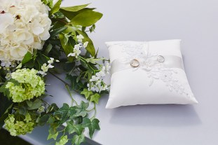 Wedding bands on pillow by Bushfire Photography