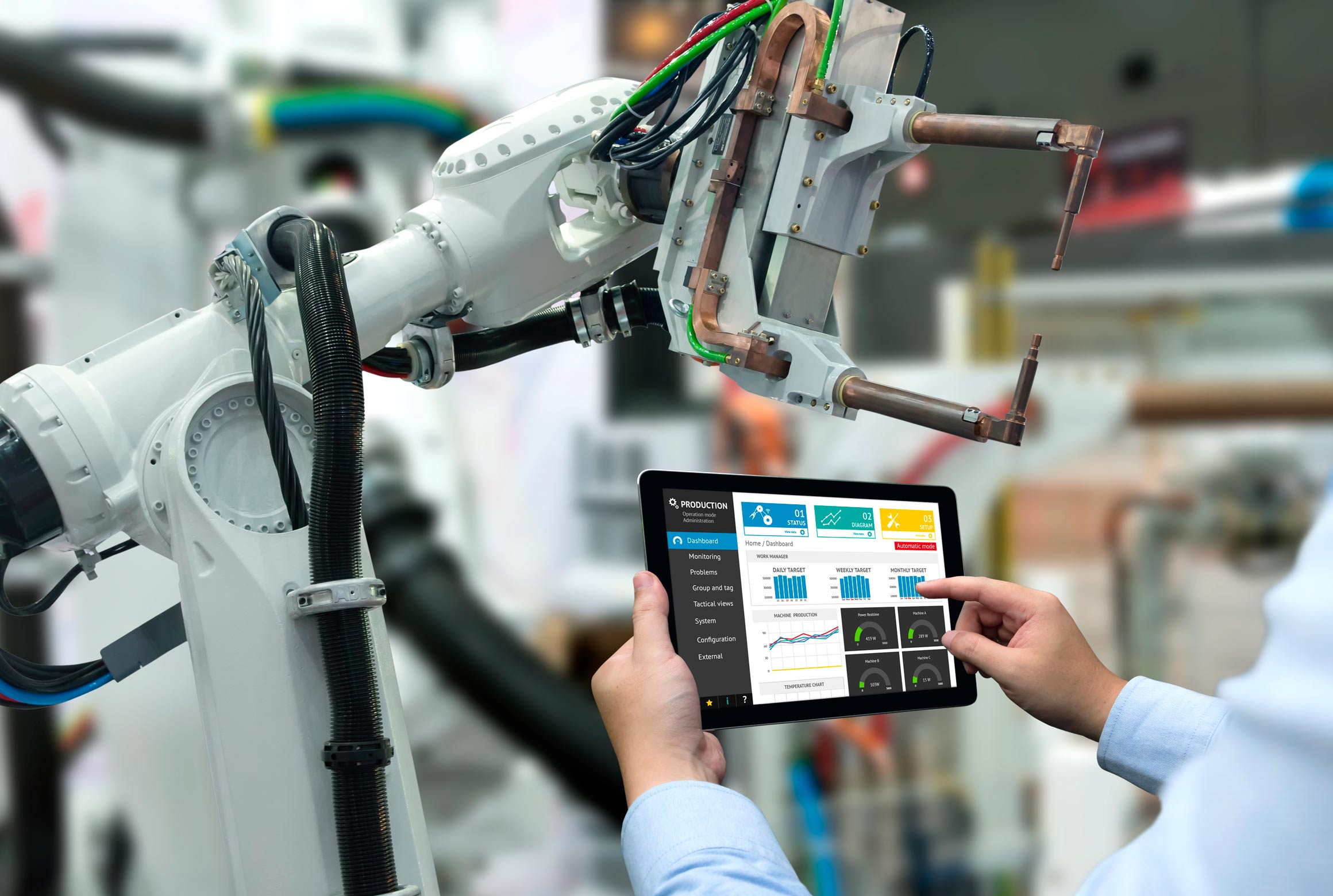 robotic arm being programmed from tablet