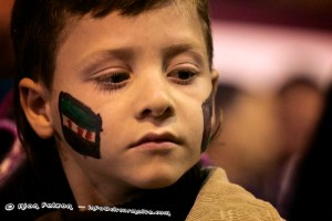 Palestine boy with Palestinians flags painted on his face