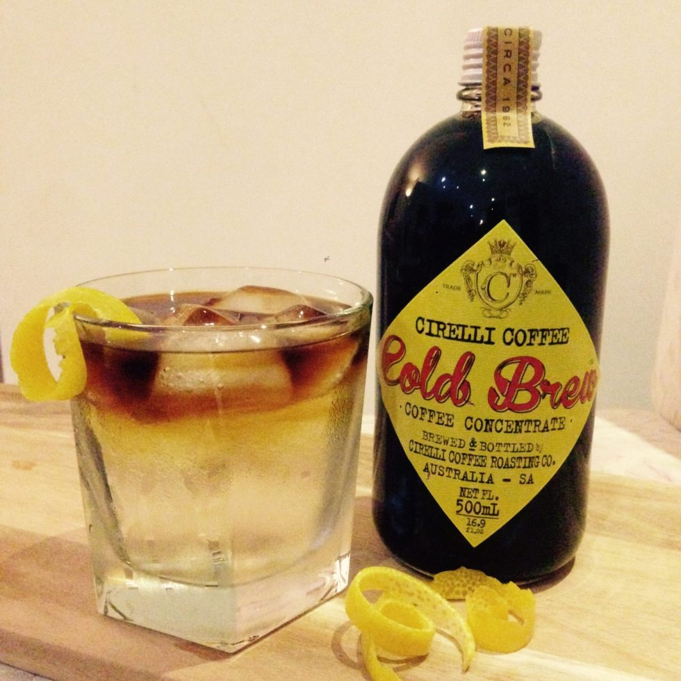 500ml cold brew bottle alongside a icyglass of gin and tonic