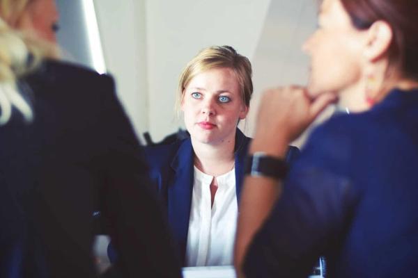 three businesswomen conversing