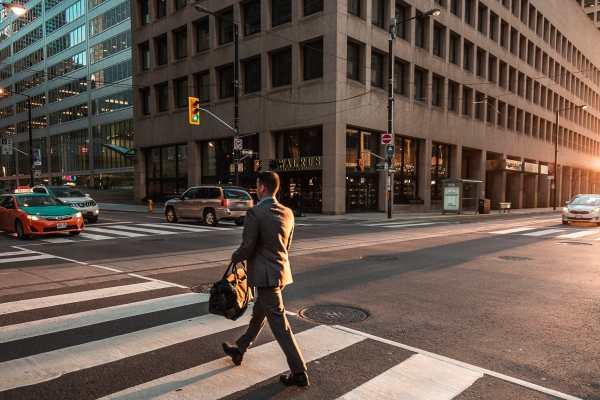 business man crossing street