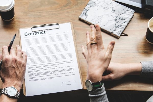 people-talking-over-contract