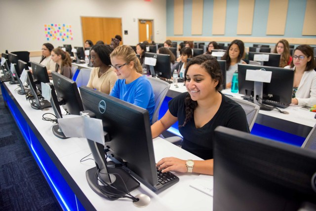 FIU Students in a lecture and lab.