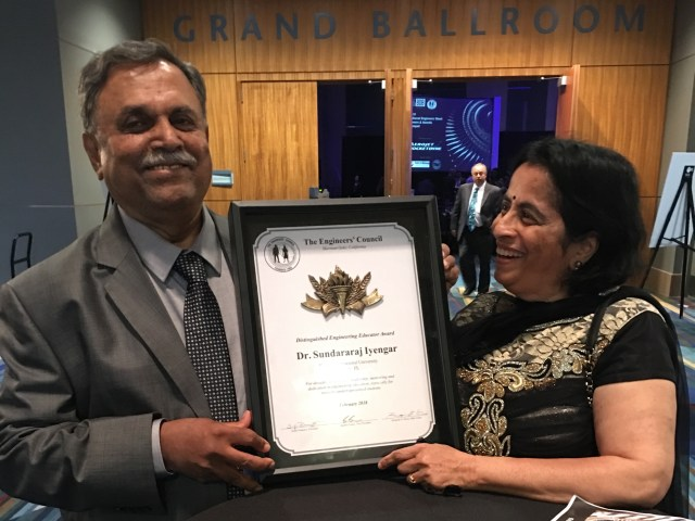 Photo of Iyengar hold his Distinguished Engineering Educator Award for 2018 presented by the Engineer's Council Award
