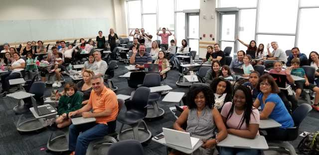 Photo of participants at Bring your parent to code day.