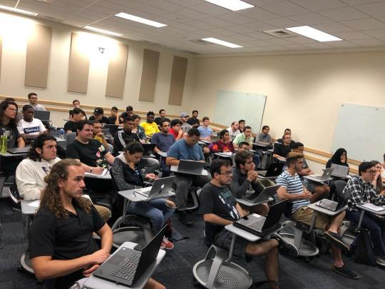 Photo of FIU students at an ACM Student Chapter Meeting.