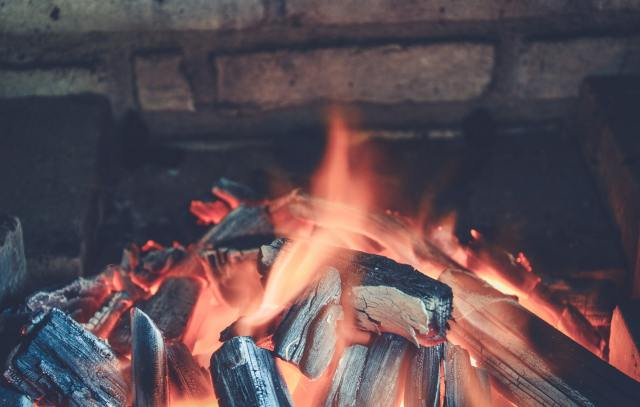 a firepit with charcoals