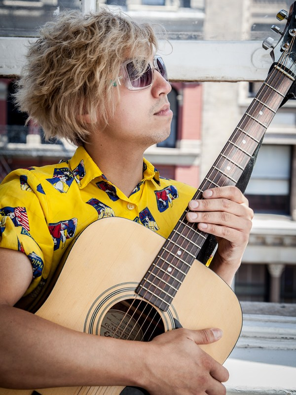 Michael Sue-Poi, guitar Photo © Raoul Beltrame