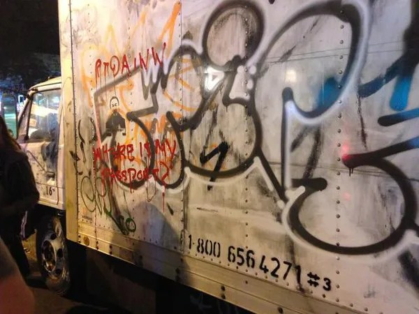 Someone tagged the truck with Ai Wei Wei-related graffiti. Photo © Jen Chung/Gothamist