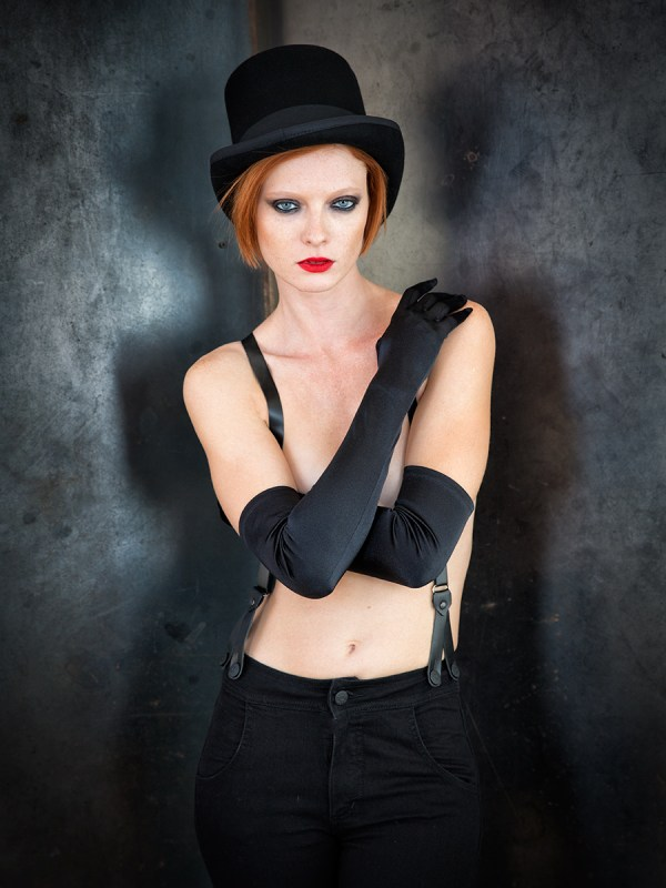 -Suspender overalls by Urban Outfitters -Satin gloves by La Crasia Gloves -Top hat by Urban Outfitters Photo © Icarus Blake