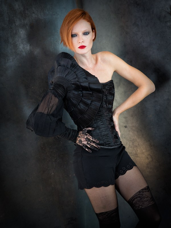 -Ruched corset with sleeve by Trappola Di Venere -Scalloped trim shorts by Buffalo -Tights by Urban Outfitters -Lace glove by La Crasia Gloves Photo © Icarus Blake
