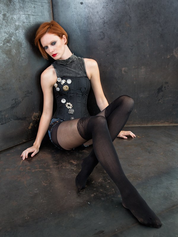 -Corset with brooches by Trappola Di Venere -High neck sleeveless tank by Urban Outfitters -Sequin shorts by Buffalo -Tights by Urban Outfitters Photo © Icarus Blake