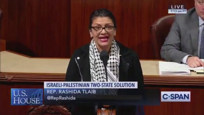Rashida Tlaib wears Palestinian Keffiyeh, slanders Israel on House floor, votes against 2-state bill…