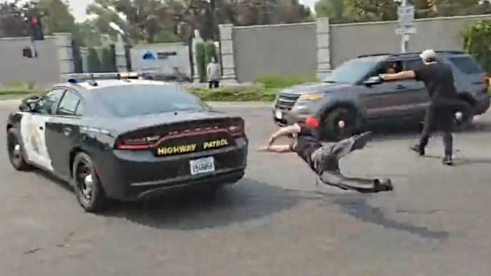 Marxist jumps on top of Sacramento police car…