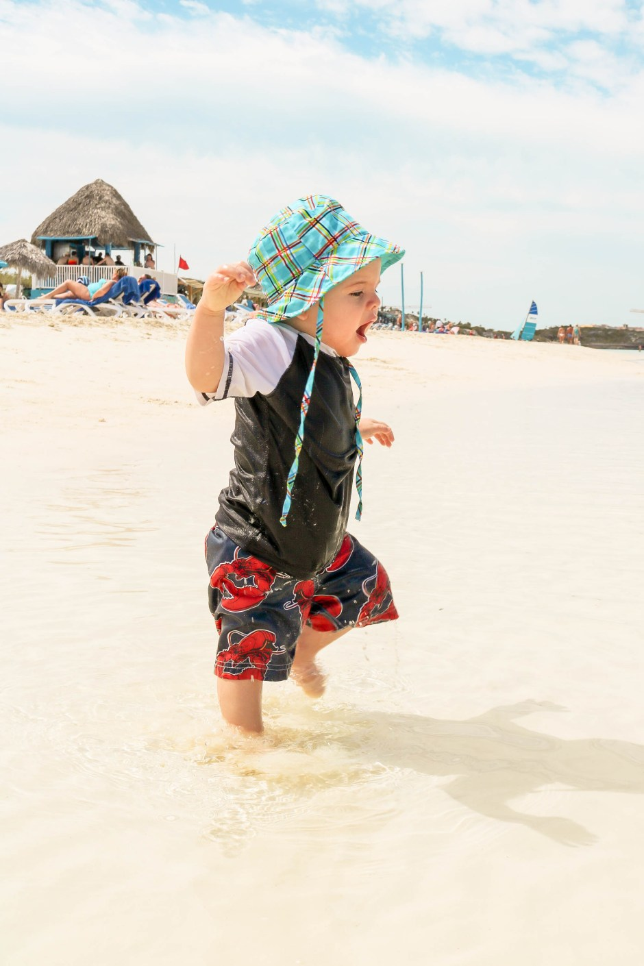 tips on travelling to cuba with toddler running at the beach