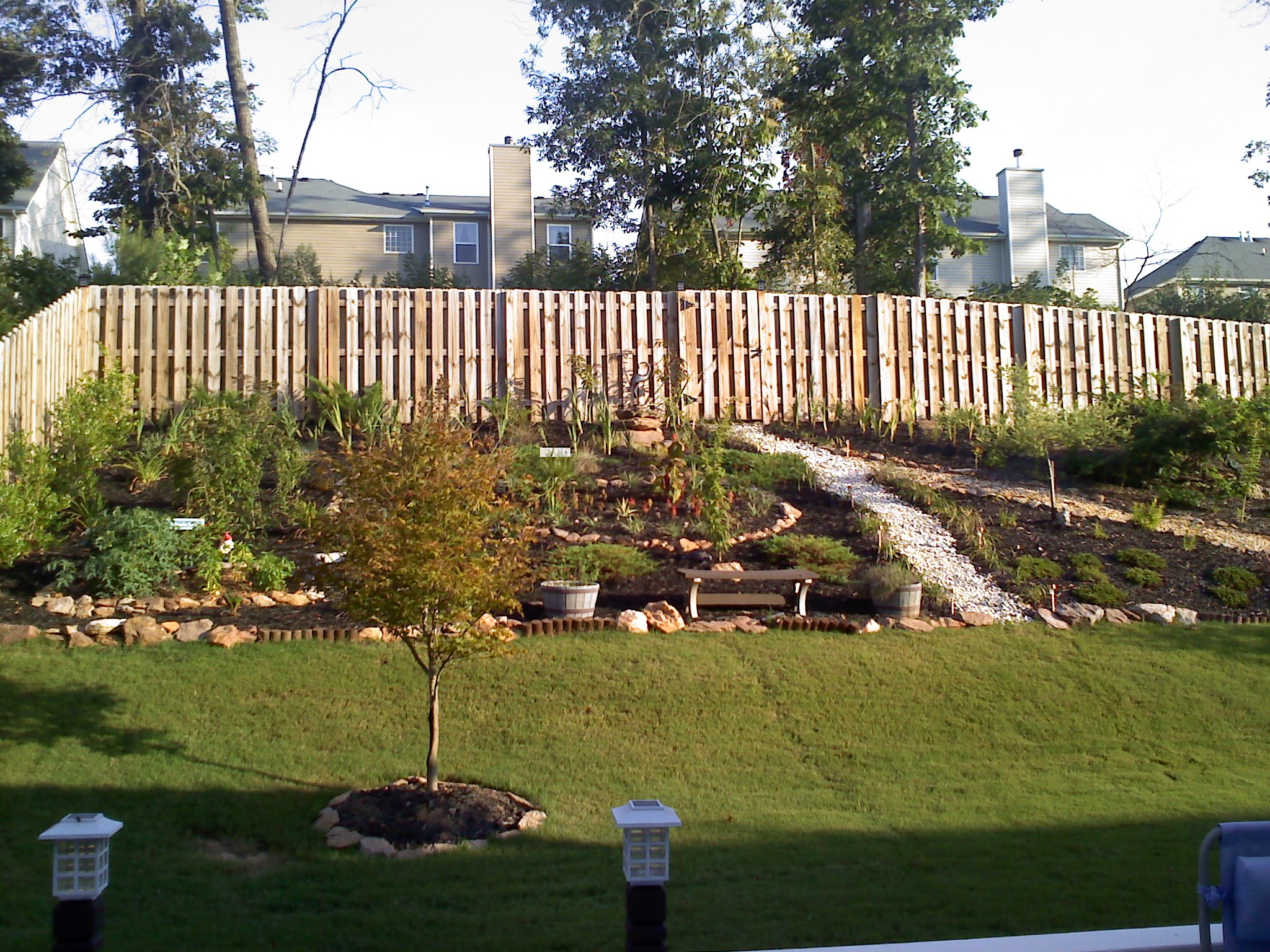 Should we install a retaining wall in our backyard ... on Wall Ideas For Yard id=44070