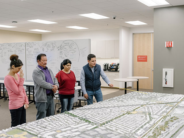Facebook executives look over plans for a high-tech residential village adjoining the company's Menlo Park corporate headquarters. (JASON HENRY/THE NEW YORK TIMES/REDUX)