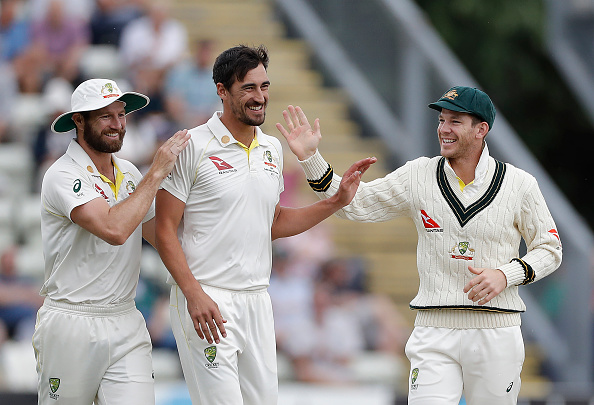 WORCESTER, ENGLAND - AUGUST 07: Mitchell Starc of Australia celebrates with Tim Paine of Australia after taking the wicket of Josh Dell of Worcestershire during day one of the Tour Match between Worcester CCC and Australia at New Road on August 07, 2019 in Worcester, England. (Photo by Ryan Pierse/Getty Images)