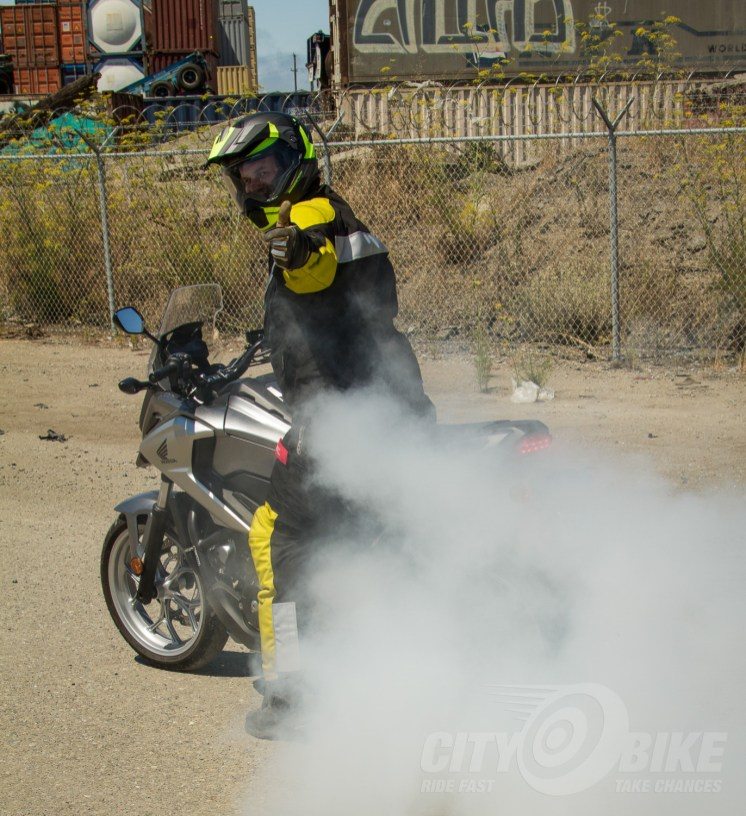 Goddamn right the NC700X does burnouts. Wheelies too. Photo: Max Klein.