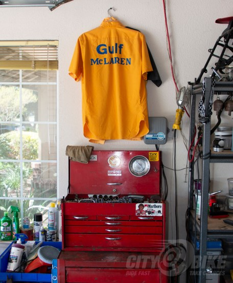 Norman's Gulf team shirt hangs in his garage.