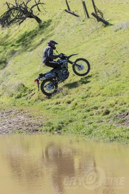Kawasaki KLX250 climbing hill.