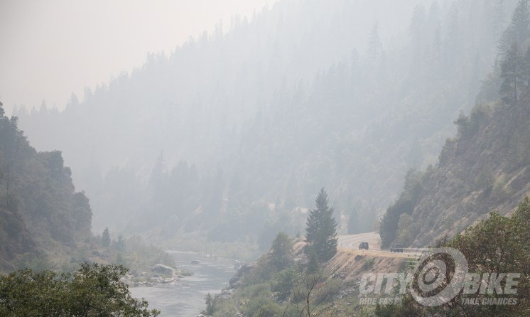 Jeeps along the Klamath River, in the smoke from the Carr Fire.