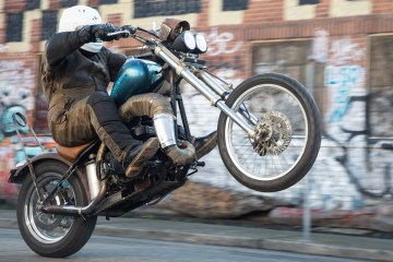 Riding SnoMoChop at Dirtbag Challenge 2018 - snowmobile-powered hardtail chopper. Photo: Angelica Rubalcaba.