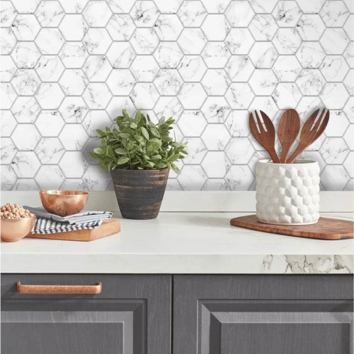 If you live in a rental home and struggle decorating it, you need to know about these removable products. From wallpaper, to flooring and backsplashes, these items will blog you away! #rentalhomedecorating #rentaldecorating #rentalapartmentdecorating #removablewallpaper #removablebacksplash #removableflooring