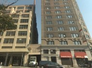 View of 233 Spring Street (left) and 161 Avenue of the Americas (right) buildings. Core building is proposed to replace the middle one-story loading dock. Credit: Google maps.