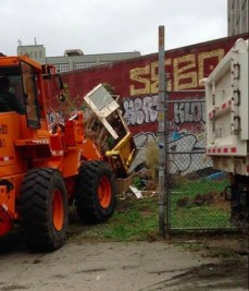 The City's Department of Sanitation bulldozed the community garden at 99 South 5th Street, Brooklyn on May 23, 2013. Image Credit: Time's Up.