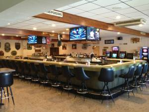 bar with tvs turned to football game